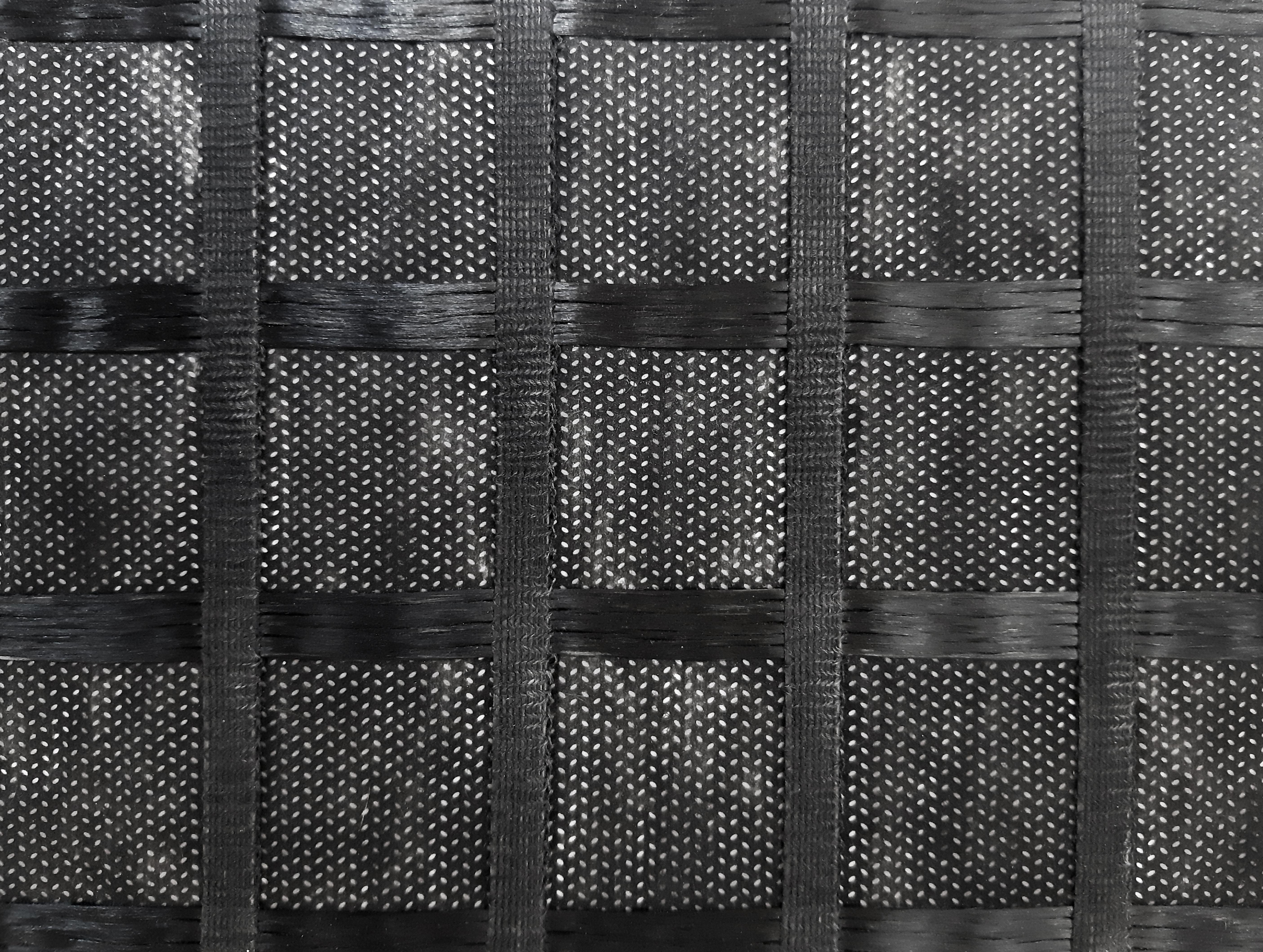 геосинтетический материал изготовленный из высокомодульных синтетических нитей основовязальным способом с последующим покрытием битумным составом